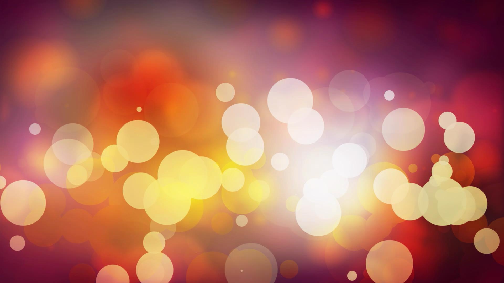 闪烁的彩色光斑粒子背景